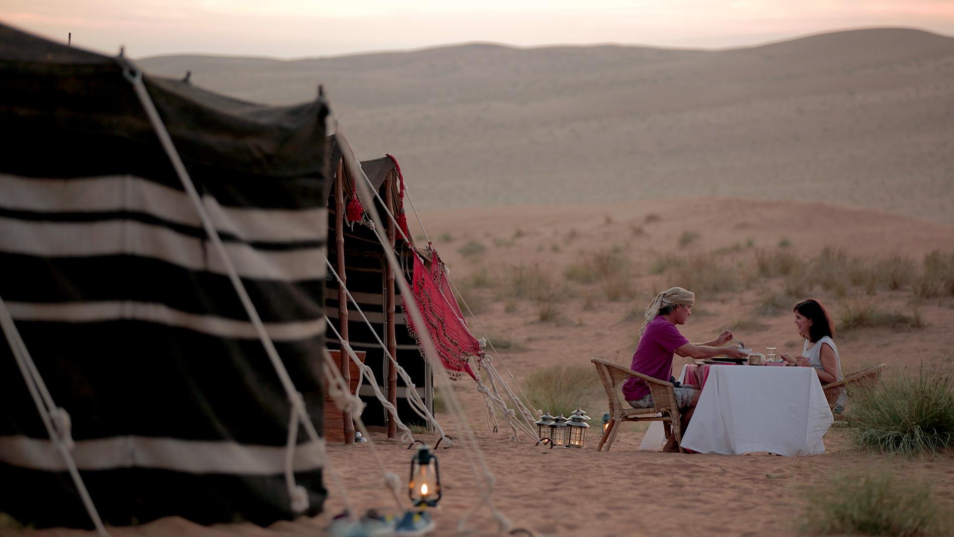 Production still from the dinner scene in the desert